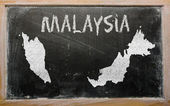 Outline map of malaysia on blackboard — Stock Photo