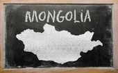 Outline map of mongolia on blackboard — Stock Photo