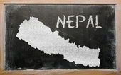 Outline map of nepal on blackboard — Zdjęcie stockowe