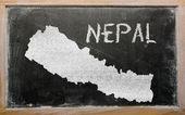 Outline map of nepal on blackboard — Stock Photo