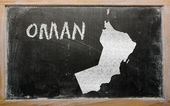 Outline map of oman on blackboard — Foto Stock