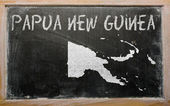 Outline map of papua new guinea on blackboard — Stok fotoğraf