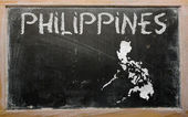 Outline map of philippines on blackboard — Stock Photo