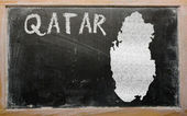 Outline map of qatar on blackboard — Stock Photo