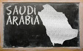 Outline map of saudi arabia on blackboard — Stock Photo