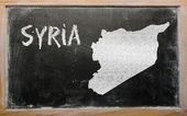 Outline map of syria on blackboard — Stock Photo