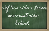 Expression - If two ride a horse, one must ride behind - writte — Stok fotoğraf