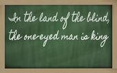 Expressie - in het land der blinden, de Eenogige man is koning — Stockfoto