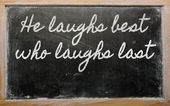 Expression - He laughs best who laughs last - written on a scho — Stock Photo