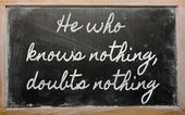 Expression - He who knows nothing, doubts nothing - written on — Stock Photo