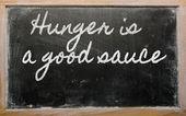 表达式-饥饿是很好的酱料-写在学校 blackb — 图库照片