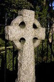 Roughly-cut stone cross — Stock Photo