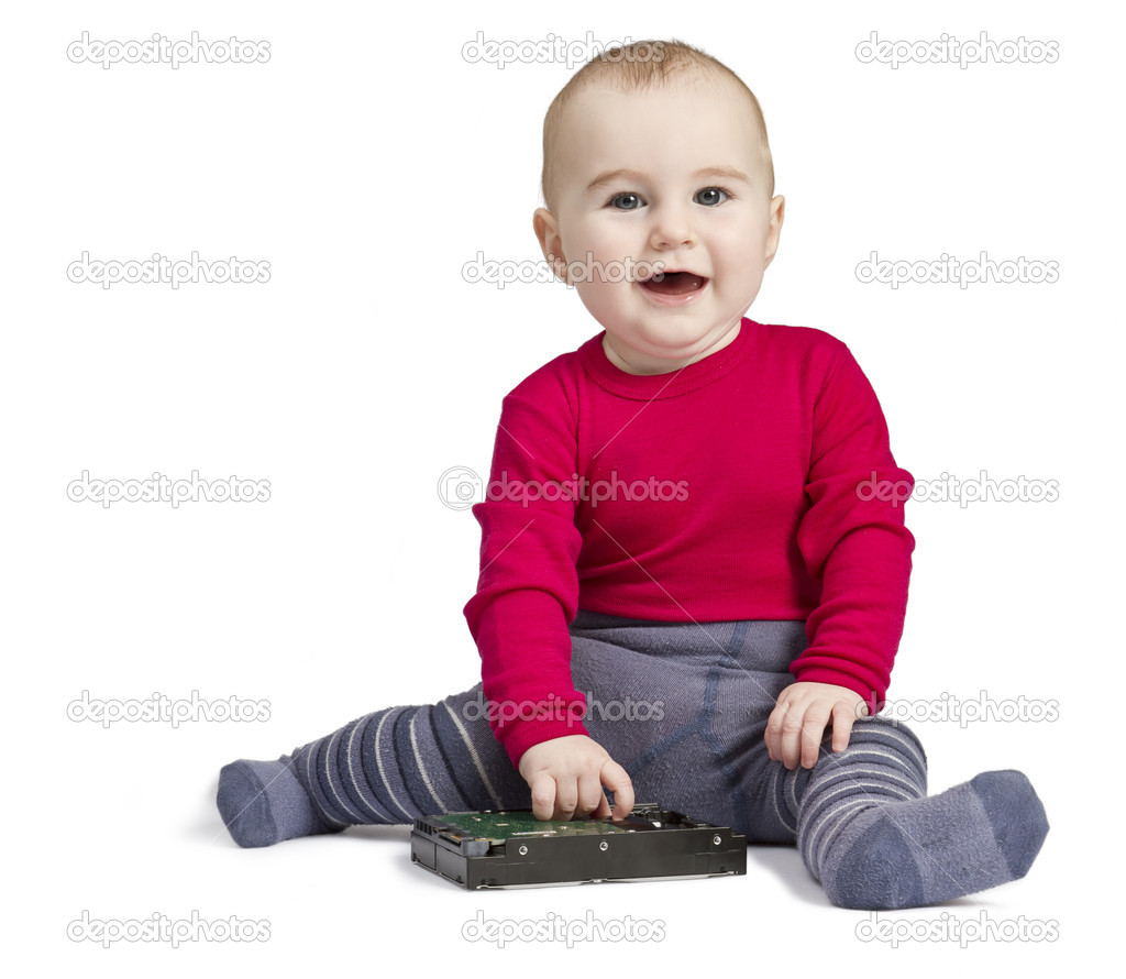 Young child in white background with hard drive. red shirt and blue trousers — Stock Photo #8551361