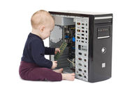 Young child with open computer — Stockfoto