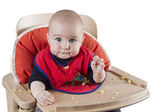Toddler eating potatoes — Stock Photo