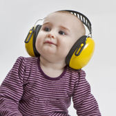 Baby with ear protection — Stock Photo