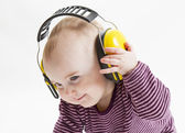 Young child with ear protector — Stock Photo