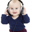 Toddler with earphones — Stock Photo