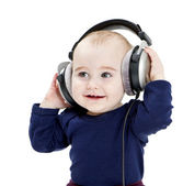 Young child with ear-phones listening to music — Stock Photo