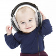 Young child with ear-phones listening to music — Stock Photo #9818835