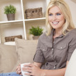 Beautiful Blond Woman Drinking Tea or Coffee At Home — Stock Photo