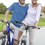 Happy Man & Woman Couple Riding Bikes — Stock Photo #8438107