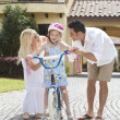 Family WIth Girl Riding Bike & Happy Parents — Stock Photo #8438981