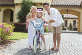 Family WIth Girl Riding Bike & Happy Parents — 图库照片