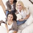 Three Beautiful Women Friends Eating Popcorn at Home — Stock Photo
