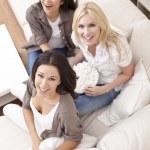 Three Beautiful Women Friends Eating Popcorn at Home — Stock Photo
