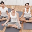 Royalty-Free Stock Photo: Interracial Group of Three Beautiful Women In Yoga Position