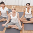 Interracial Group of Three Beautiful Women In Yoga Position — Stock Photo #8442884