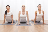 Interracial Group of Three Beautiful Women In Yoga Position — Stok fotoğraf