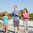 Three Interracial Young Adult Friends Running Jogging — Stock Photo #8462490
