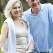 Stock Photo: Happy Senior Man & Woman Couple Cycling Bicycles