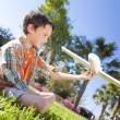 Young Boy Playing WIth Model Airplane Outside — Stock Photo