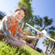 Young Boy Playing WIth Model Airplane Outside - Stock Photo