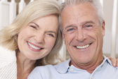 Happy Senior Man & Woman Couple Smiling at Home — Stockfoto