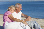Happy Romantic Senior Couple Sitting Together on Beach — Stock Photo
