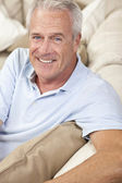Happy Handsome Senior Man Smiling at Home — Stock Photo