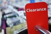 Sale Clearance Sign On Rail in Clothes Shop — Stock Photo