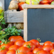 Tomatoes and price — Stock Photo