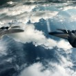 Two F-22 Raptors in high attitude above clouds — Stock Photo #9541319