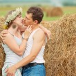 Romantic couple near haystack — Stock Photo