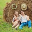 Romantic couple near haystack — Stock Photo