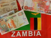 Zambian money and flag — Stock Photo