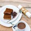 Chocolate cake, cup of coffe and black chocolate — Stock Photo