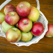 Stock Photo: Basket full of ripe apples