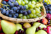 Fresh organic fruits in the wicker basket — Foto de Stock