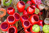 Colored poppy pods and colored wickerwork — Stock Photo